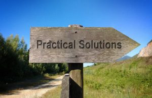 wooden sign reading Practical Solutions